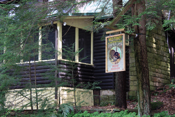 Wild Turkey Riverfront Cabins - Front view of the Cabin with screened in Front Porch