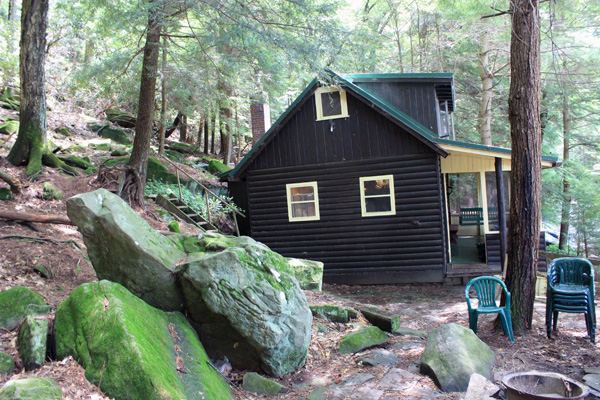 Wild Turkey Riverfront Cabins - Side view of the Cabin with Fire Ring in the foreground
