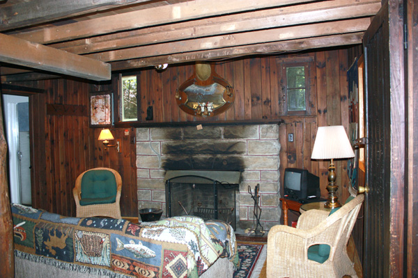 Wild Turkey Riverfront Cabins - Living Room with Stone Fireplace