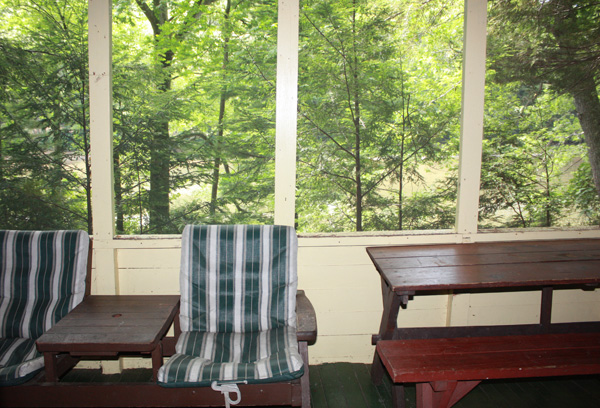 Wild Turkey Riverfront Cabins - Front porch with River in the background